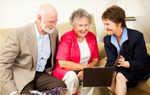 Older couple learning about life insurance.